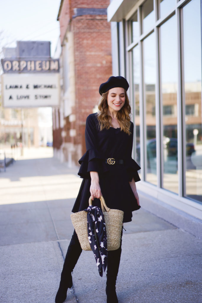 An all black outfit paired with a straw basket bag